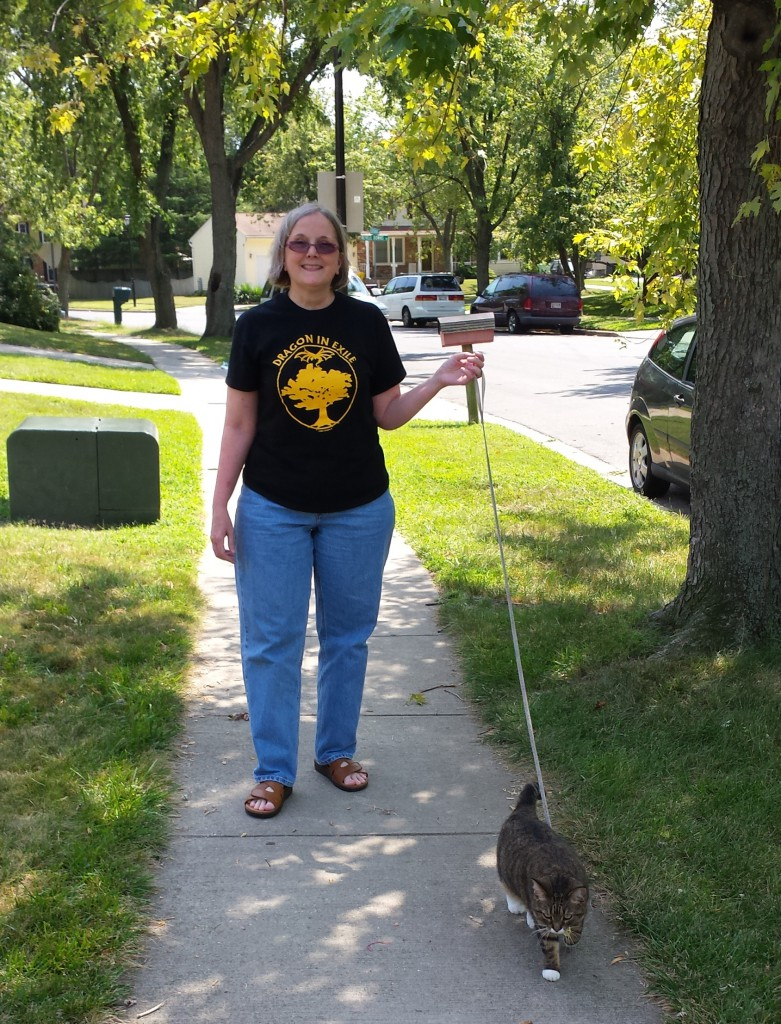 Barbara Field White: Here I am doing it like a Delm walking my cat, Smogens.