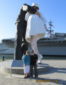 "Dale & Gayle Stroble: Photo of us at ""The Kiss"" statue in San Diego, CA next to the USS Midway museum."