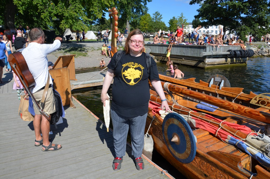 Eva Norman: Standing at the side a Viking re-enactment ship from 1912. I´m Doing it like a Delm in Stockholm, Sweden.