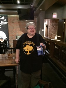 Harriet Culver and her Sasquan Membership Badge after the Making Light dinner at Saranac, 8/20/2015.
