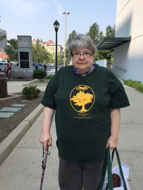 """Harriet Culver: Walking back from the Friends of Liad breakfast at Sante on Sunday morning. And I can't tell you how many folk at Sasquan that day commented on the """"Plan B is now in effect"""" slogan on the tee back. (Not sure they recognized the book tho'.)"""