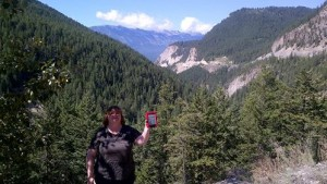 "Peggy Kemp - just off the Trans-Canada Highway .  I'm traveling through the Rocky Mountains near Golden, British Columbia, Canada - accompanied by ""Dragon in Exile"" and an entire Library of Liaden Universe books."