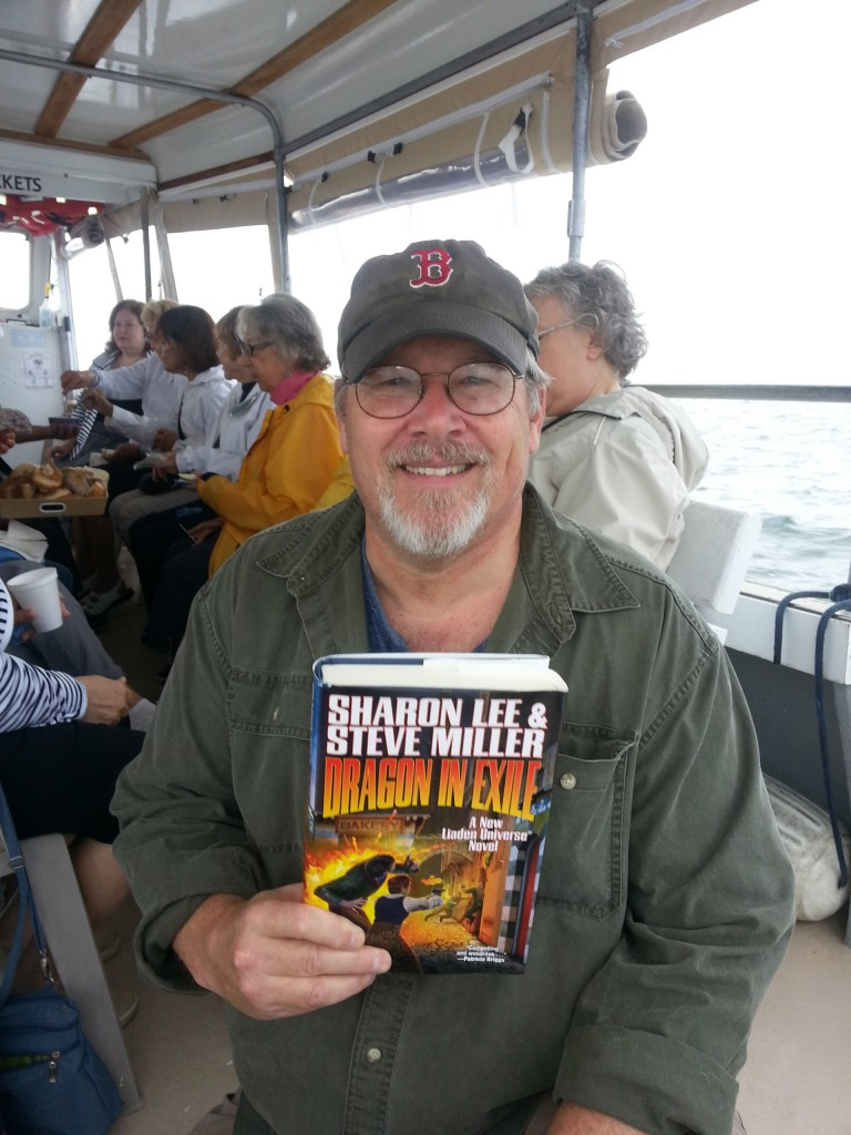 Alan Brown: My wife was invited to go on a knitting cruise on Narragansett Bay. But while she loves yarn and knitting, crowds and boats can make her nervous. So she brought me along for moral support. But what's a guy to do on a knitting cruise when he doesn't knit? Why, read his favorite yarns, of course! Which explains the attached picture.