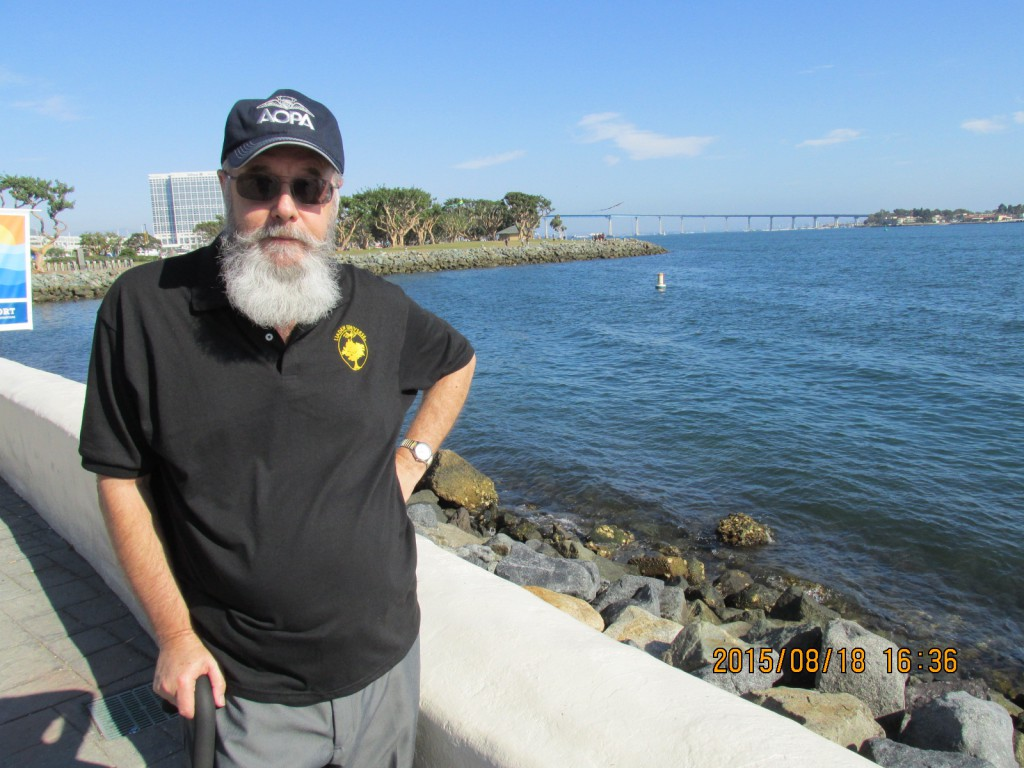 Dale Stroble: I'm at the Seaport Village tourist trap looking toward the Coronado Bay Bridge in San Diego, CA. Not terribly exciting but there was no camera back in 1975 when I and several co-workers walked on the catwalk underneath the bridge from the Coronado side back to San Diego. That was exciting! The catwalk was expanded metal and only had a simple pipe railing on each side.