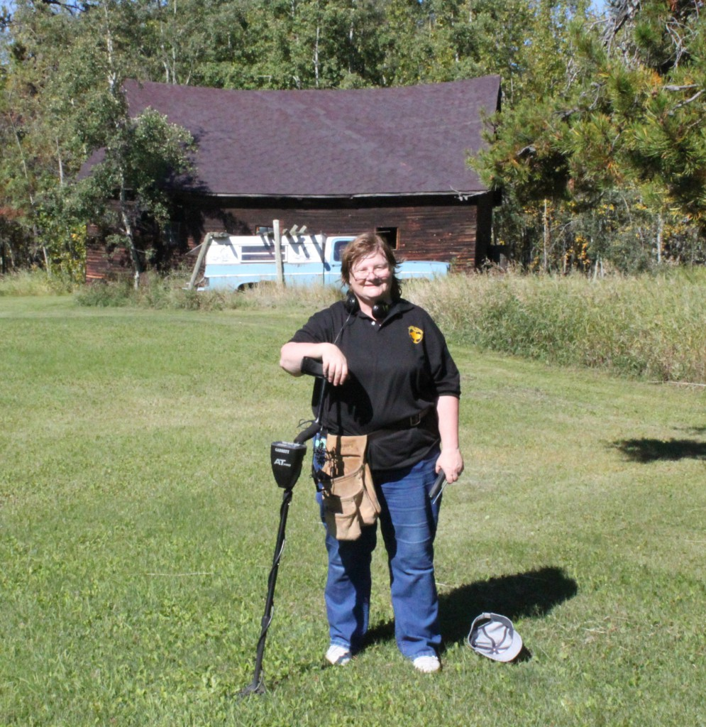 Peggy Kemp: At a metal detecting rally in Sundre Alberta (near the Rocky Mountains). I am wearing my Liad T-shirt - and did not forget my kindle, which contains the Liad universe (well ... almost). I came home from the event with silver coins from 3 British Monarch eras (George V, George VI and Elizabeth II), a few foreign coins, and won a Baroque pearl key-chain. Leon Kemp (husband, and also a Liad fan) did the photography for the event (his hobby)